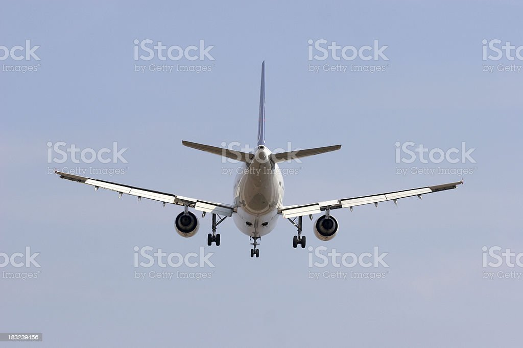 Airplane from behind royalty-free stock photo