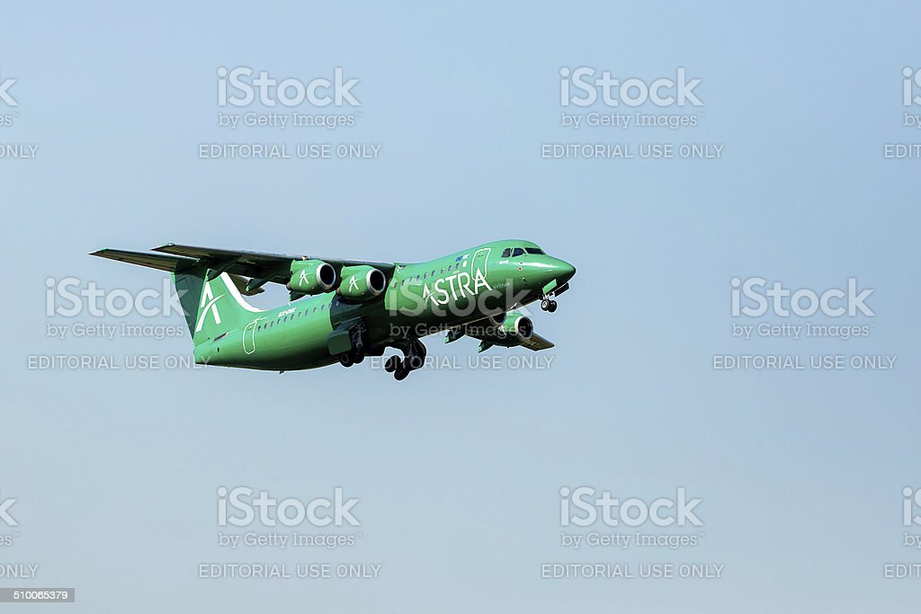Airplane from the Astra airline takes off in Greece. stock photo