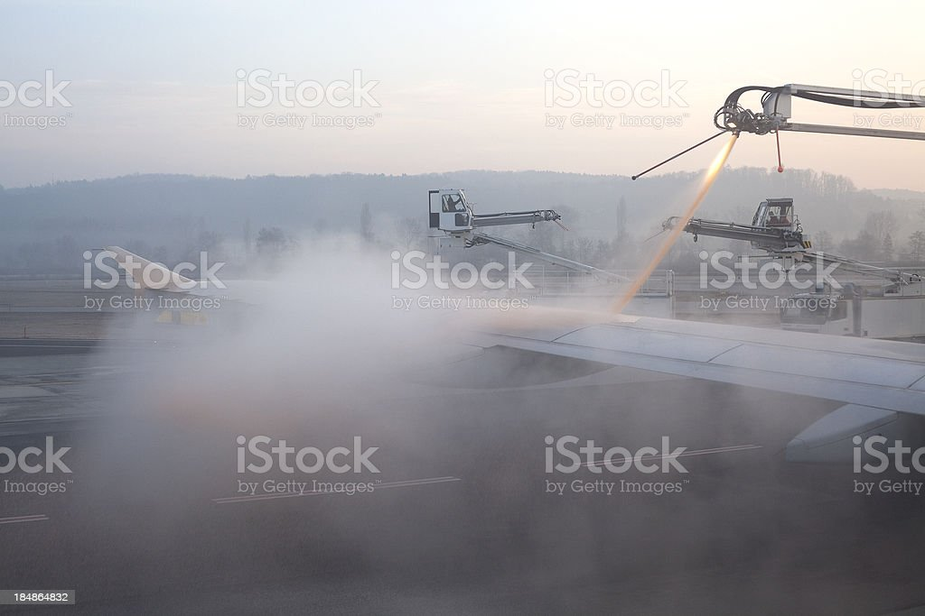 Airplane getting de-iced stock photo
