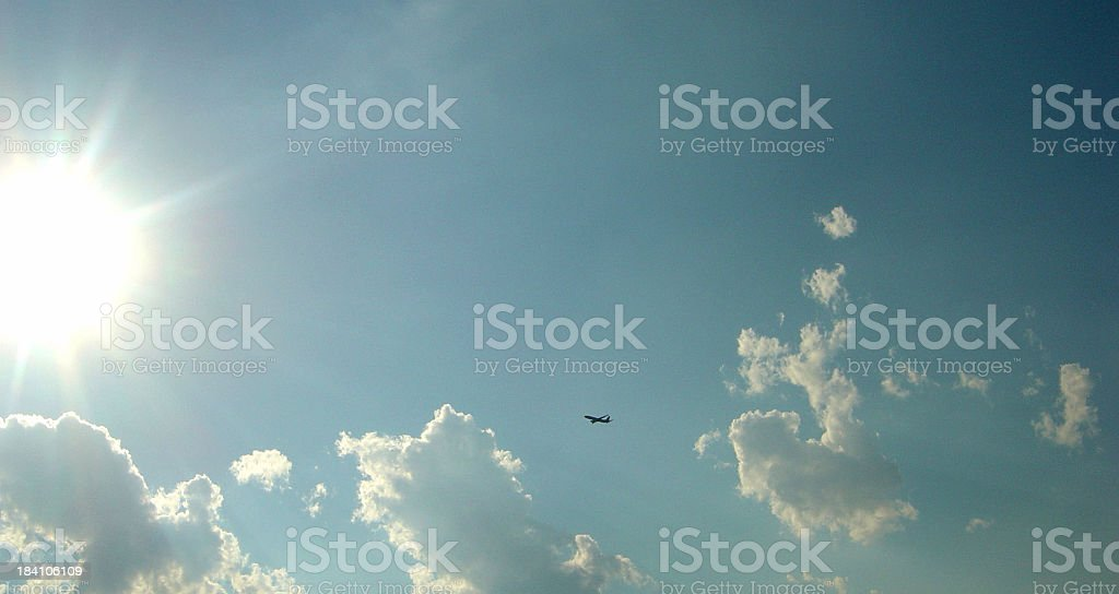 Airplane High In The Sky Fyling Through Clouds royalty-free stock photo