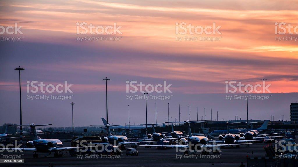 Airplane illuminated by sunset light stock photo