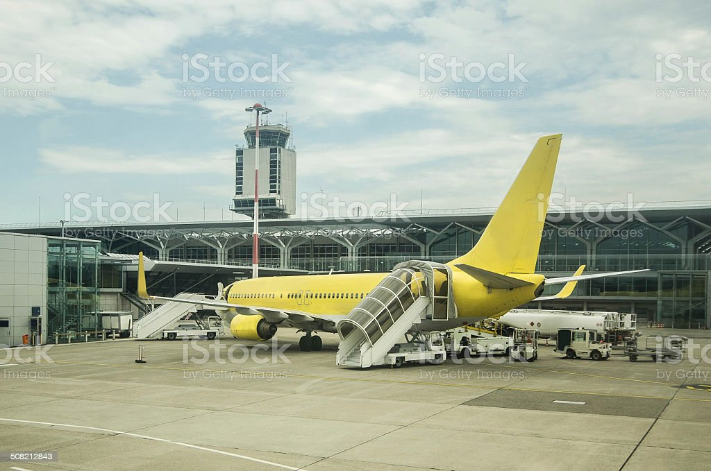 Airplane in airport stock photo