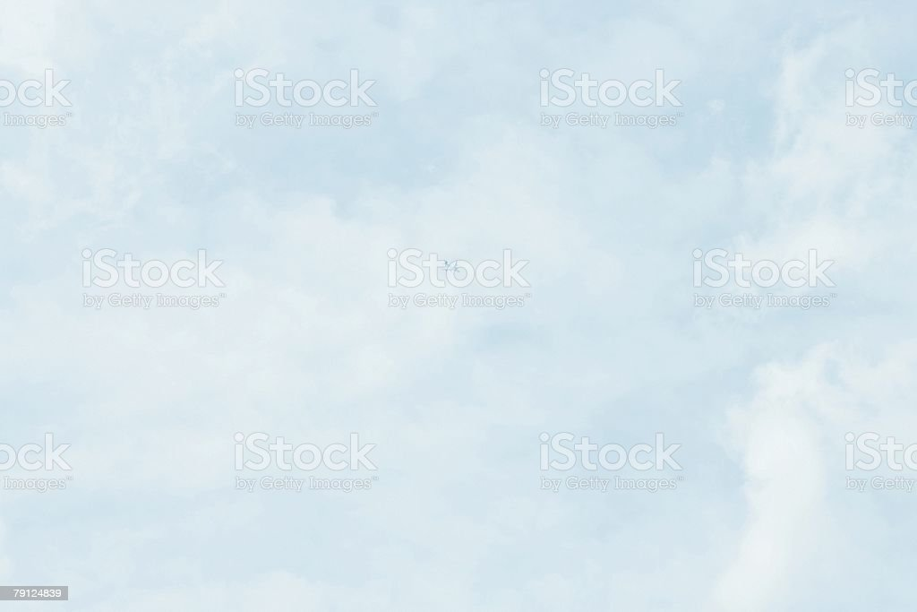 Airplane in cloudy sky royalty-free stock photo