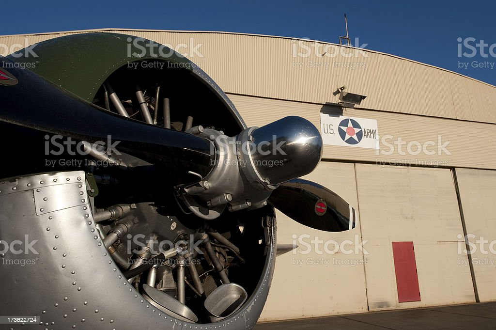 Airplane in front of Army hanger royalty-free stock photo