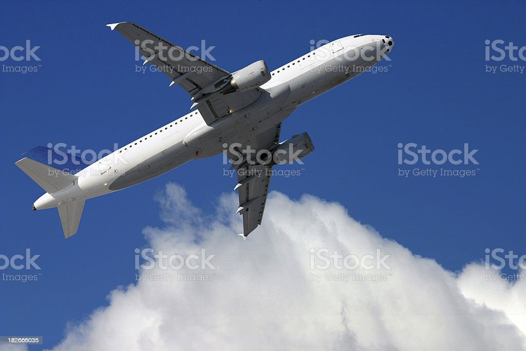 Airplane in front of cloudy blue sky royalty-free stock photo