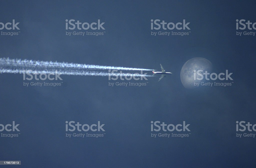 Airplane in front of the moon stock photo