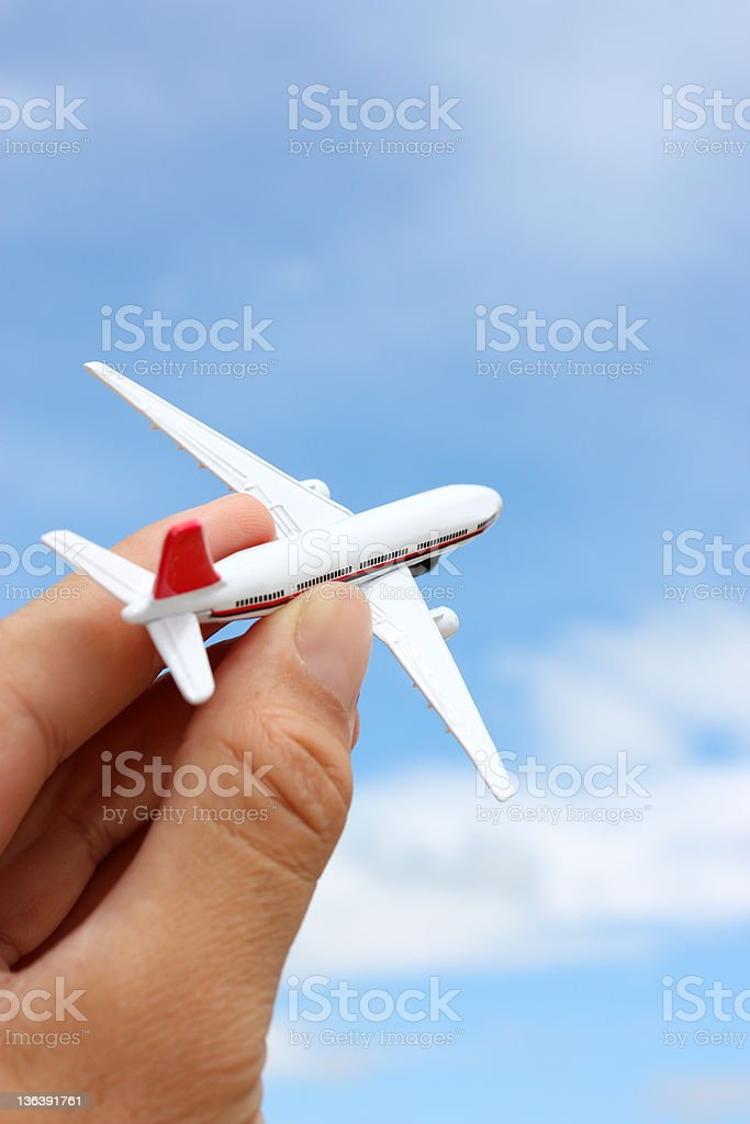 Airplane in Hand on Blue Sky royalty-free stock photo