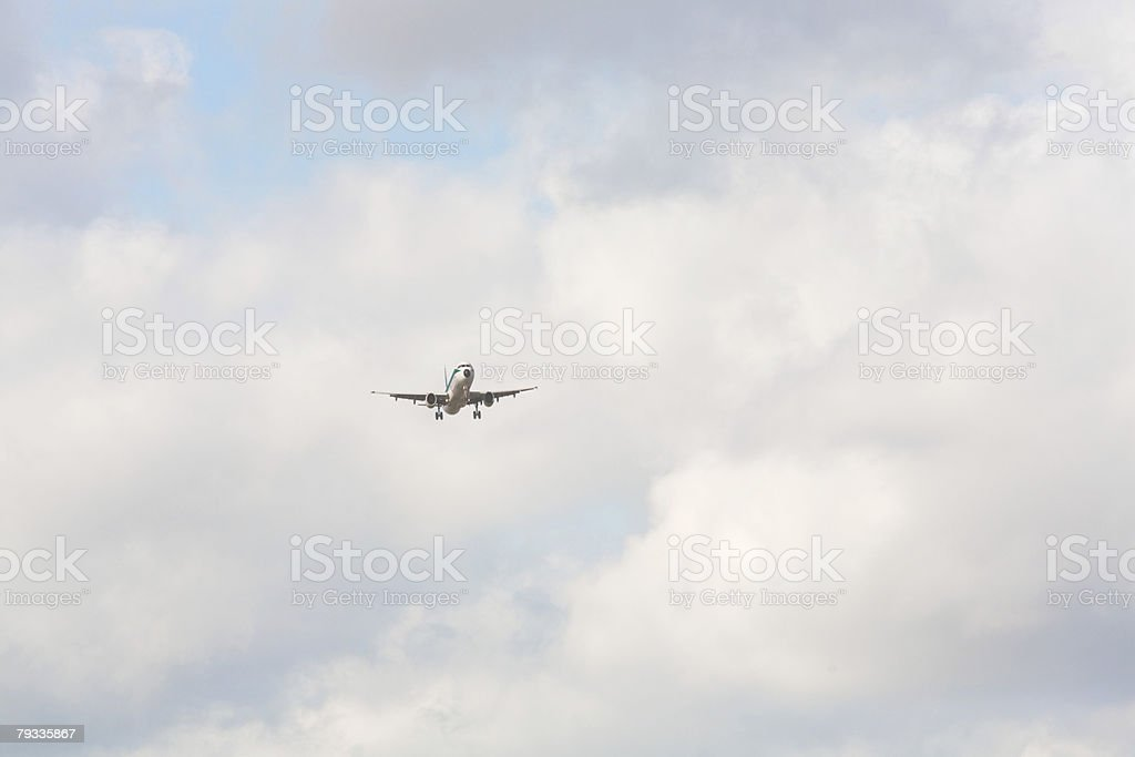 Airplane in sky stock photo