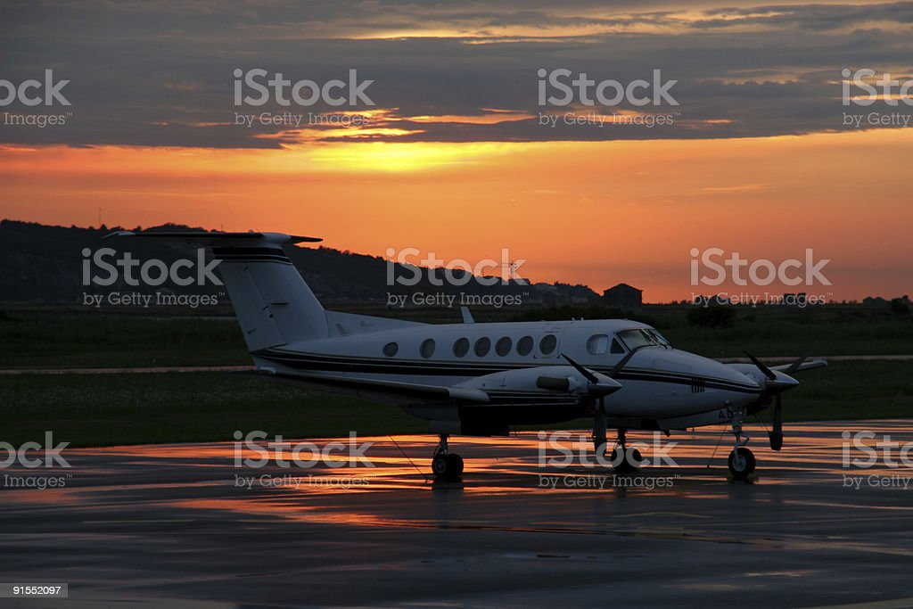 Airplane in sunset stock photo