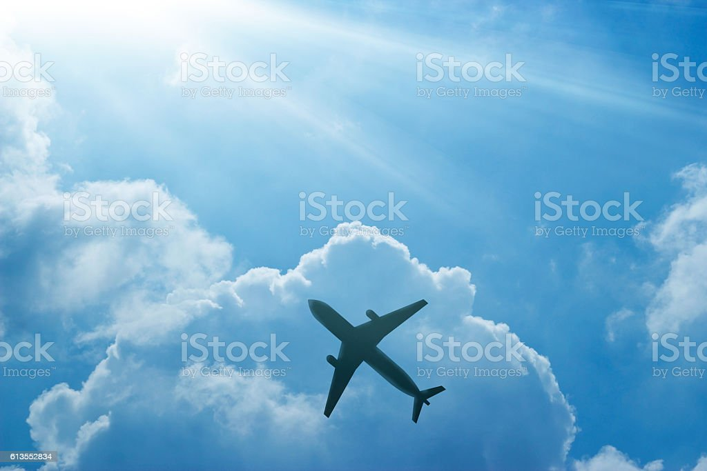 Airplane in the blue sky and cloud at sunrise stock photo