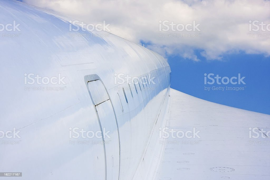 airplane in the blue sky royalty-free stock photo