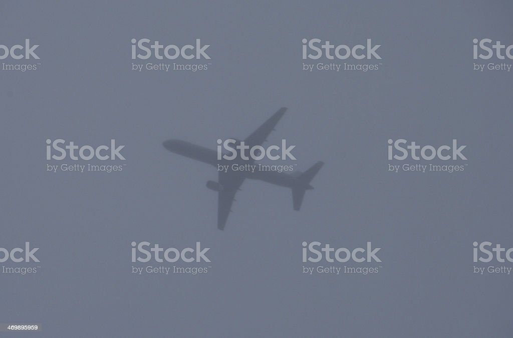 Airplane in the clouds royalty-free stock photo