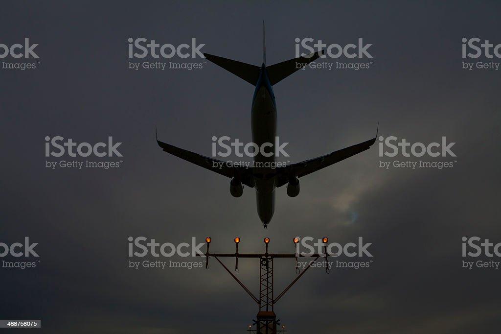 Airplane in the dark sky stock photo