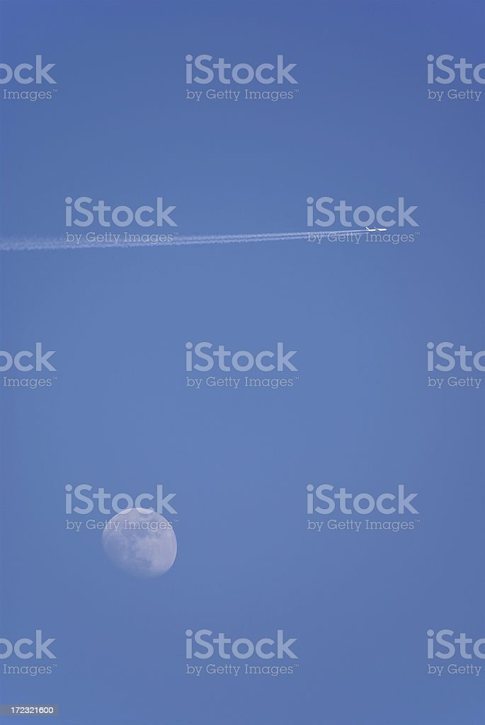 Airplane in the sky with moon stock photo