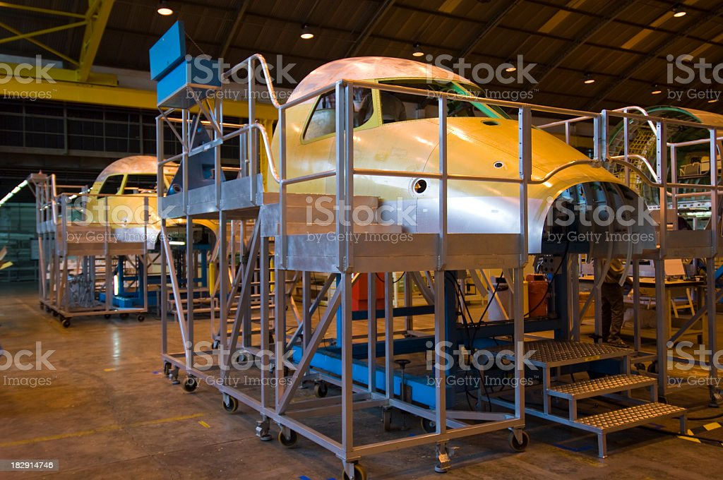 Airplane industry with airplane heads locked in cages stock photo