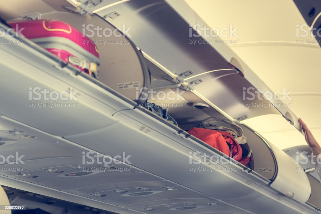 Airplane interior with overhead luggage compartment. stock photo