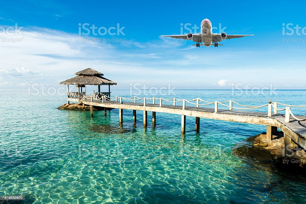 Airplane is arriving tropical resort in the morning. stock photo