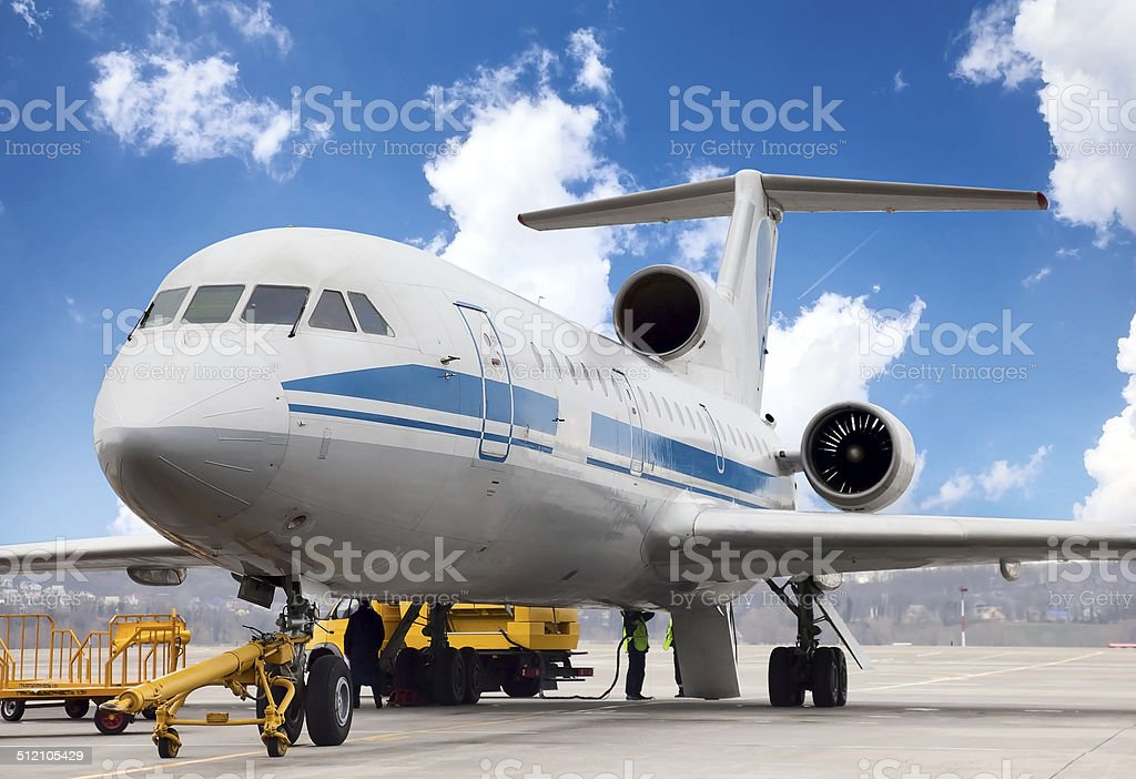 Airplane is being serviced stock photo