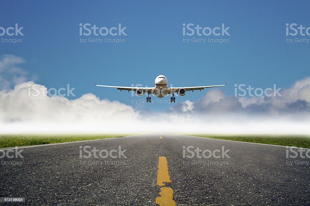 airplane is landing at airport stock photo