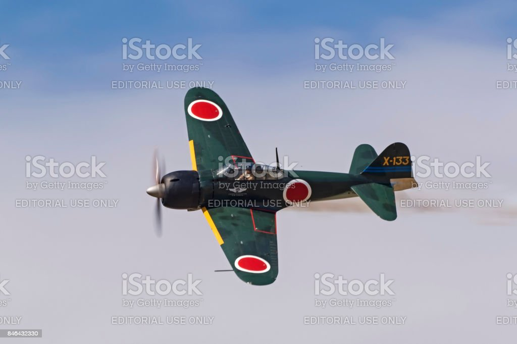 Airplane Japanese WWII Zero fighter aircraft flying at the airshow stock photo