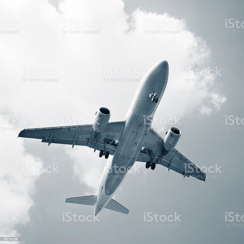 Airplane - landing approach, low-angle view royalty-free stock photo