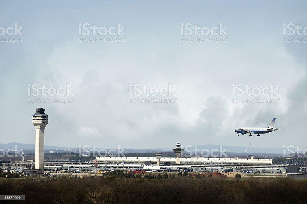 Airplane Landing at Airport stock photo
