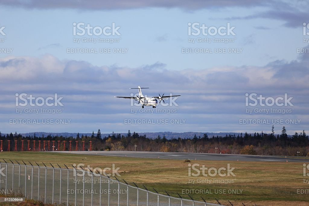 Airplane landing at Halifax Stanfield International Airport stock photo