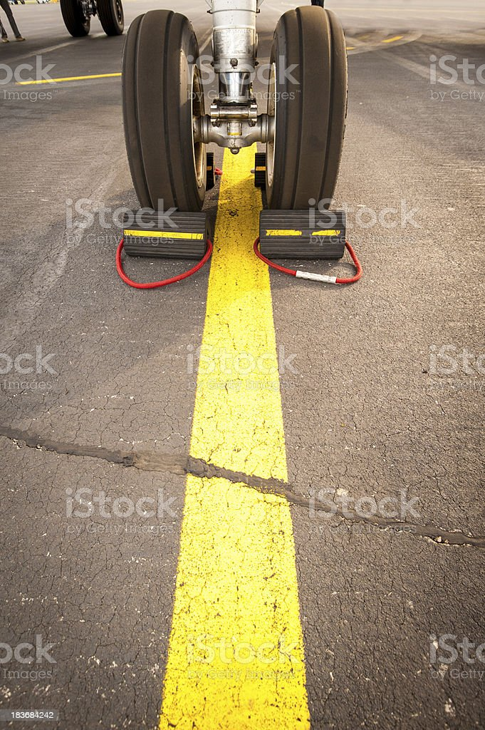 Airplane landing gear on yellow line stock photo