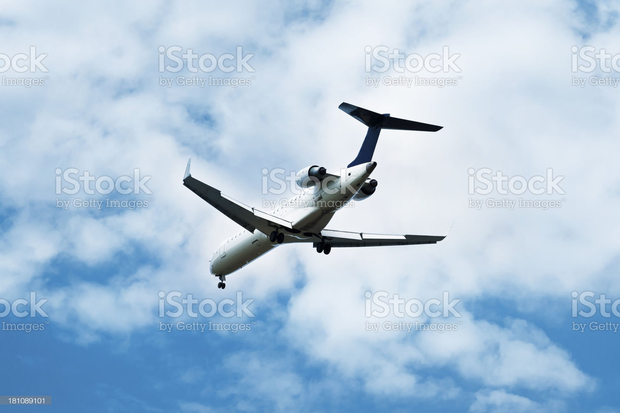 airplane landing in bright sky royalty-free stock photo