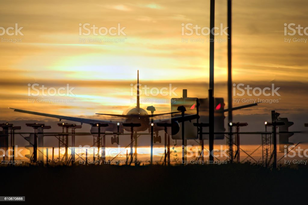 Airplane landing in sunset double exposure stock photo