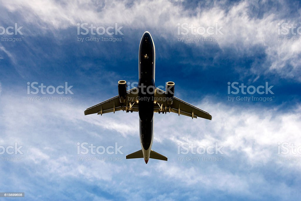 Airplane landing in sunset stock photo