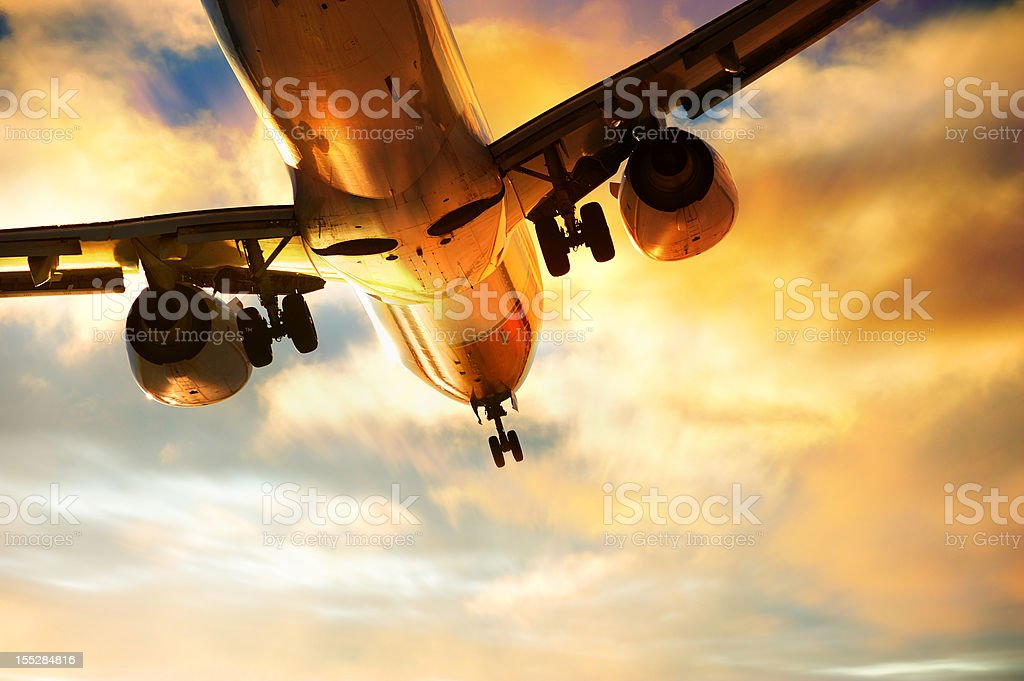 Airplane landing in the eveing stock photo