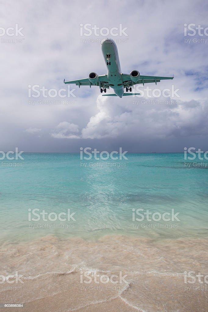 Airplane Landing near Beach stock photo