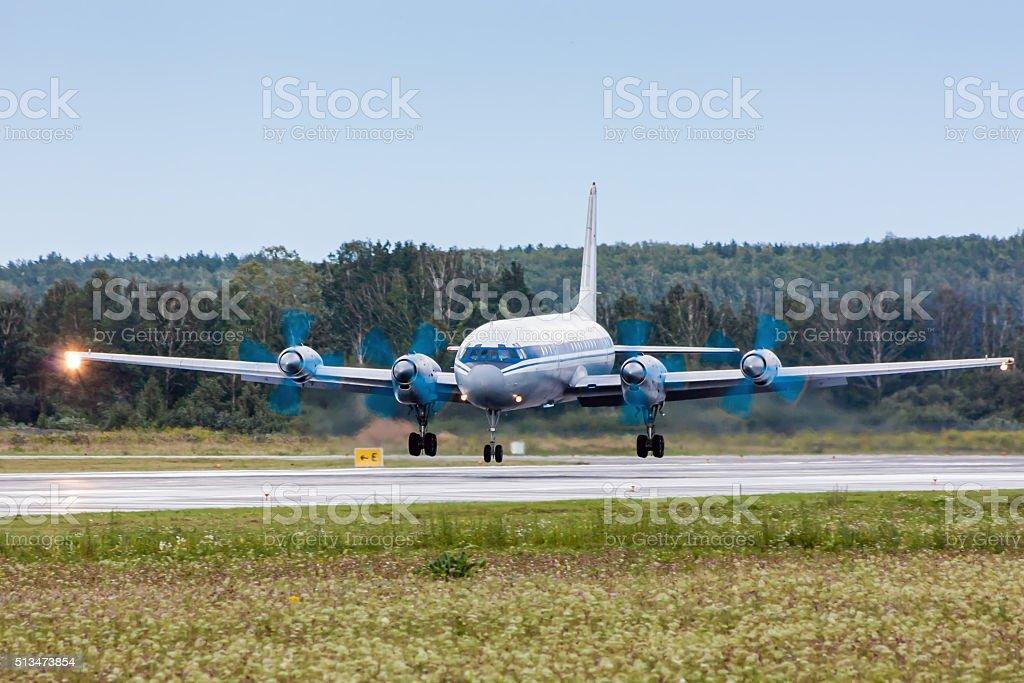 Airplane landing on runway royalty-free stock photo