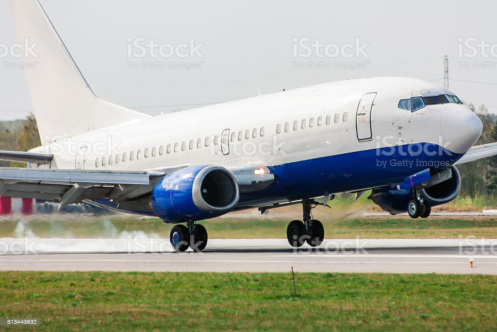 Airplane landing on runway. Touchdown with tire smoke royalty-free stock photo