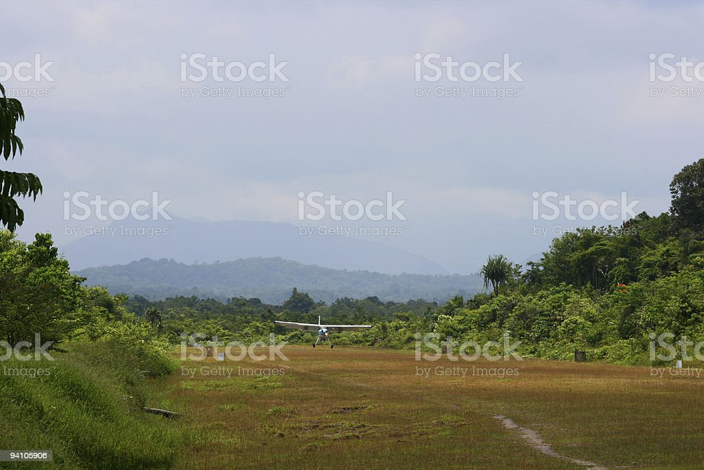 Airplane landing on rural airstrip royalty-free stock photo