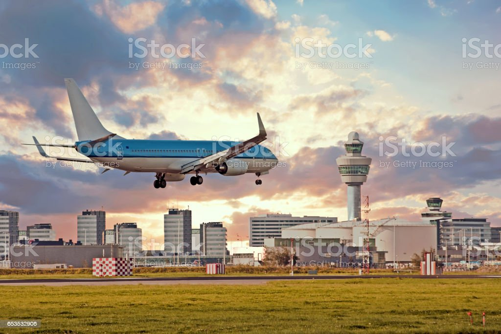 Airplane landing on Schiphol airport in Amsterdam in the Netherlands stock photo
