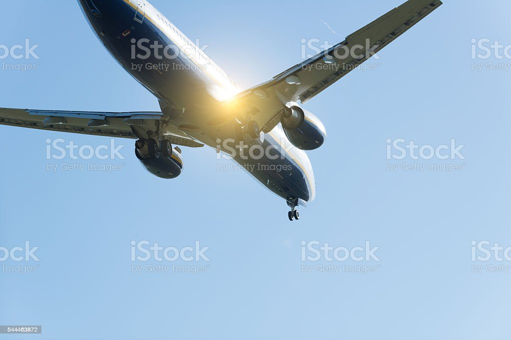 airplane landing or starting with sun reflection stock photo