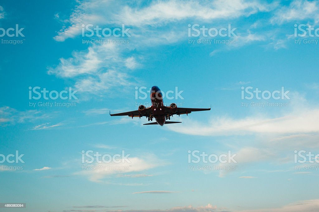 Airplane landing with pretty sky in background stock photo