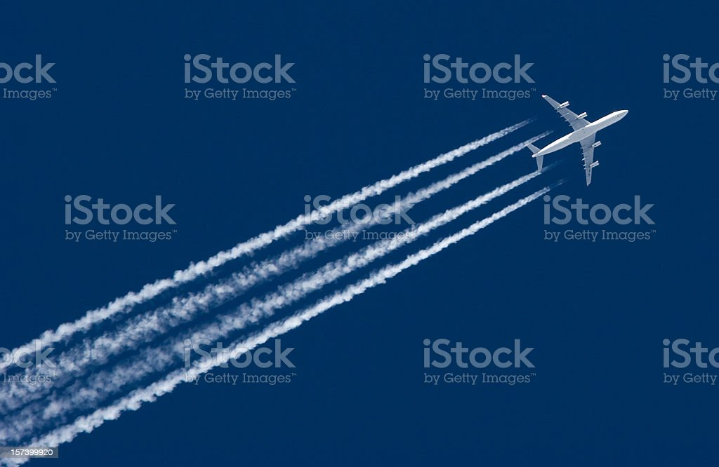 Airplane Leaving Contrail stock photo