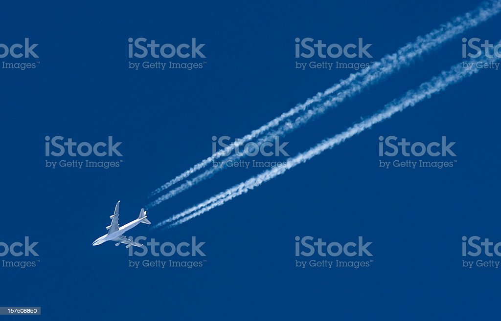 Airplane Leaving Contrail royalty-free stock photo