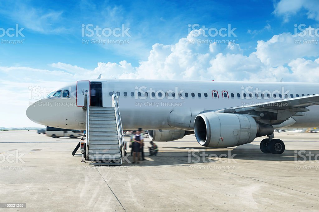 Airplane loading at the airport on a sunny day stock photo
