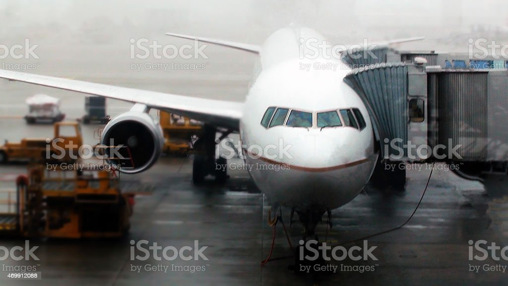 Airplane loading for departure stock photo