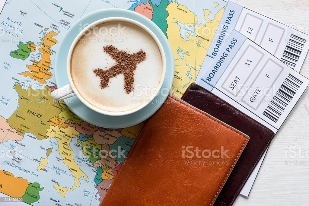 Airplane made of cinnamon in cappuccino, Passports and Europe map stock photo