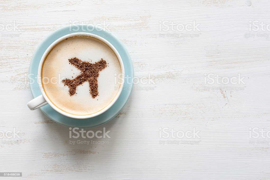 Airplane made of cinnamon in cappuccino , white background stock photo