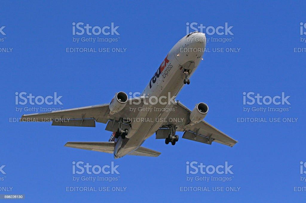Airplane MD-11 FedEx transport landing stock photo