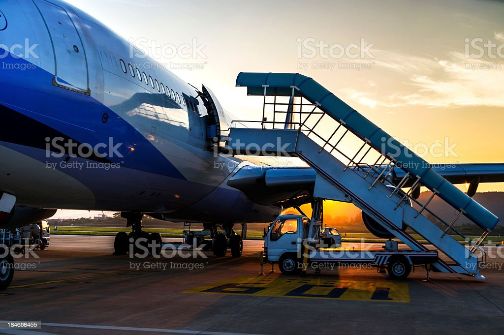 Airplane near the terminal in an airport stock photo