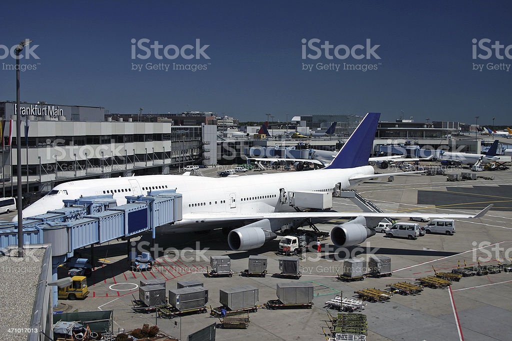 Airplane next to airport terminal prepared for flight royalty-free stock photo