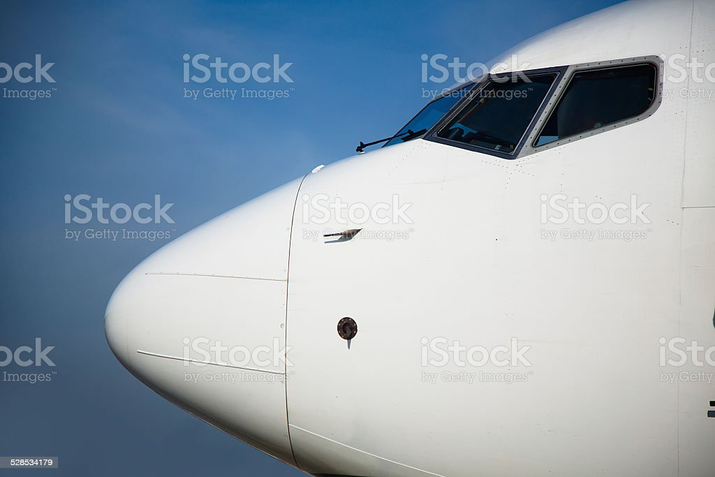Airplane nose with blue sky in the background stock photo