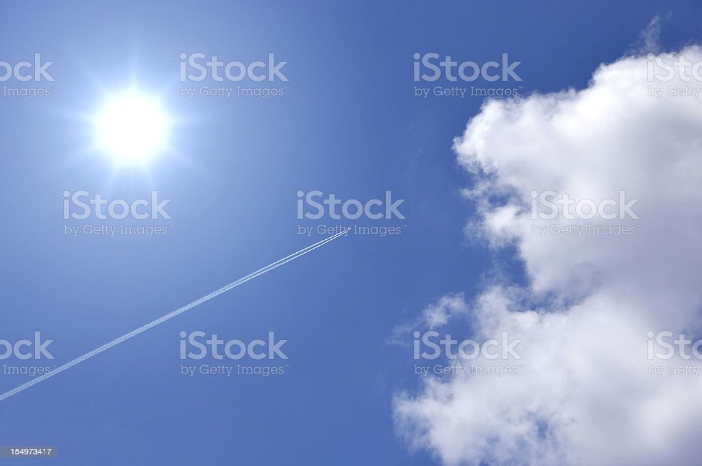 Airplane on blue sky royalty-free stock photo